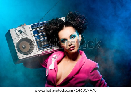 Girl with a tape recorder at the disco - stock photo