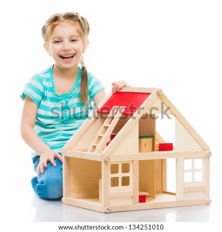 girl with a toy house ove? white background - stock photo