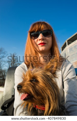 girl with a Yorkshire Terrier - stock photo