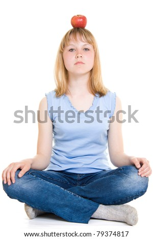Girl with an apple on a white background. - stock photo