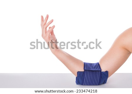 Girl with an elbow injury, ice-cooled gel. Sports injuries. - stock photo