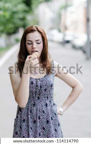 girl with an ice-cream on the street