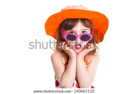 girl with an orange on a white background - stock photo