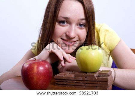 Girl with apples and chocolate.