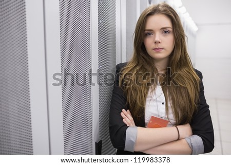 Girl with arms crossed  working at data storage facility - stock photo