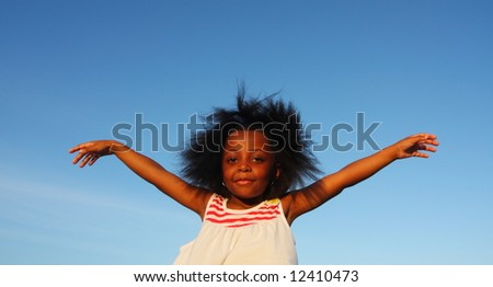 Girl with arms extended to the side - stock photo