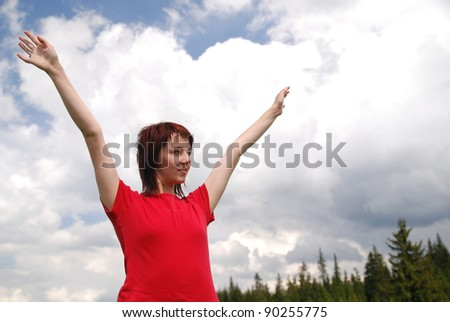 girl with arms wide open and sky background (Multiple values) - stock photo