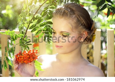 girl with ashberries on a light background