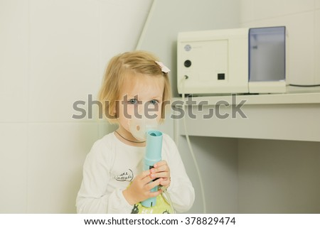 Girl with asthma inhaler. - stock photo