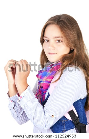 girl with backpack showing heart by hands isolated over white background