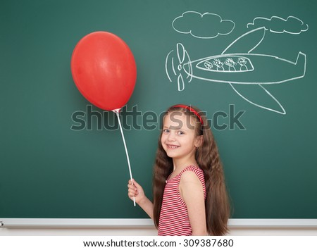 girl with balloon draw plane on school board - stock photo