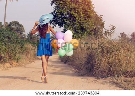 Girl with balloons. Vintage style - stock photo