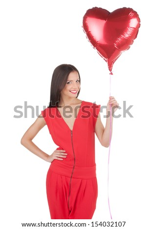 Girl with baloons. Beautiful young woman holding baloon and smiling while isolated on white