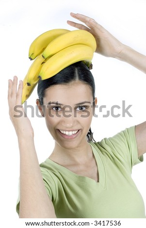 girl with bananas on her head