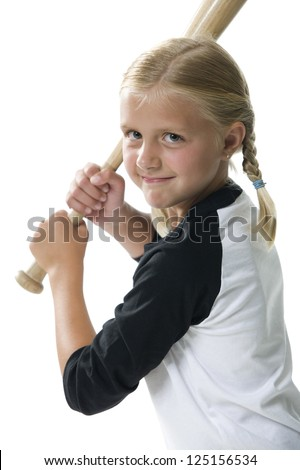 Girl with baseball bat ready to hit - stock photo