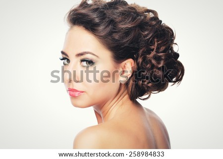 girl with beautiful hair in evening dress with flowers in her hair bride