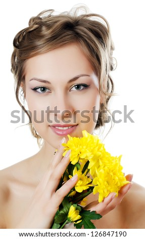 Girl with beautiful hair with yellow chrysanthemum - stock photo