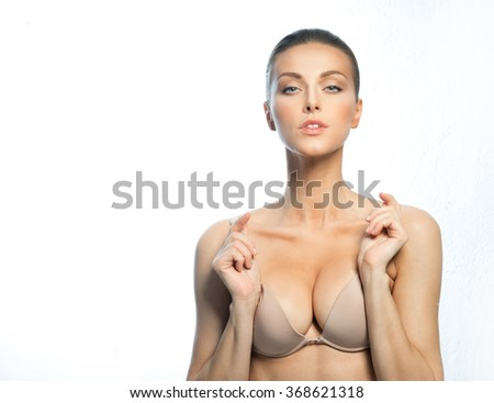 Girl with beautiful, large breasts after plastic surgery. - stock photo