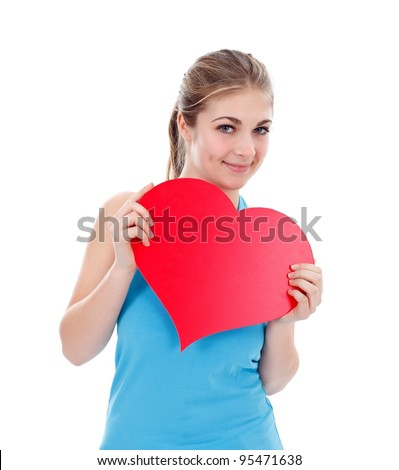 Girl with big red paper heart in her hand - stock photo