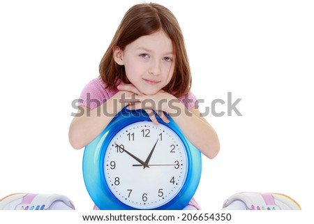 Girl with big round the clock.happy childhood, carefree childhood concept. - stock photo