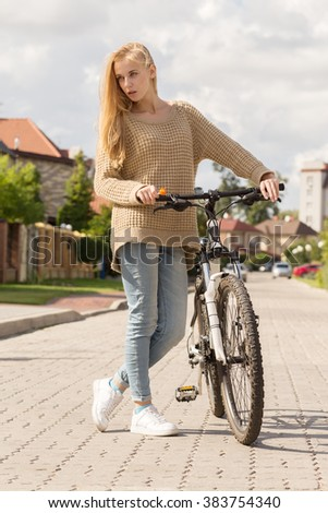 girl with bike in village