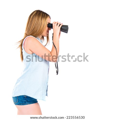 Girl with binoculars over isolated white background.