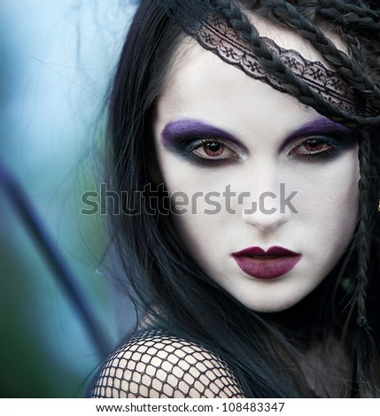 girl with black hair with dark make-up. image for the cover of book
