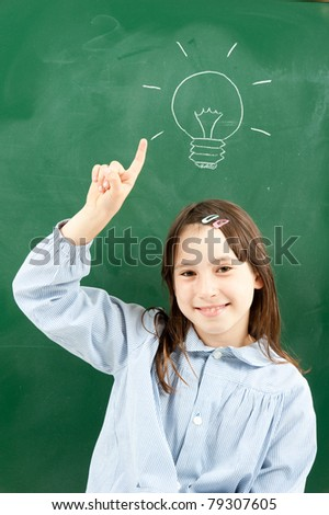 girl with blackboard and lightbulb over her head - stock photo