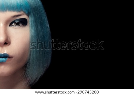 Girl with blue hair and lipstick isolated on black background. Studio shooting. Beauty and fashion make up - stock photo