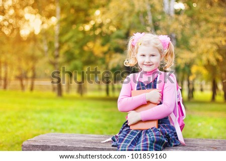 girl with book outdoor - stock photo