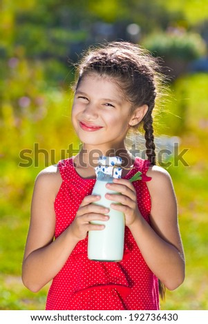 Girl with bottle of milk - stock photo
