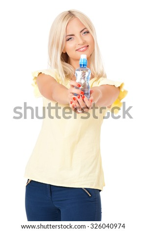 Girl with bottle of water, isolated on white background  - stock photo