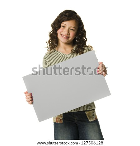 Girl with braces holding blank sign and smiling - stock photo
