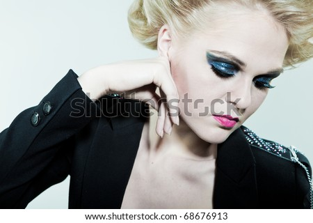 girl with bright makeup on eyes with his hands for the person