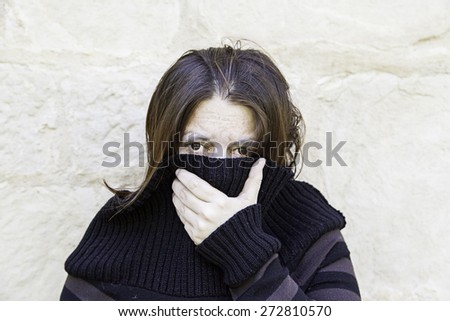 Girl with bruises fear in urban street - stock photo