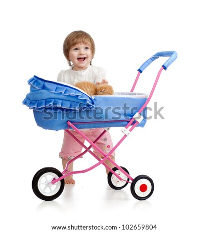 girl with buggy and kitten inside - stock photo