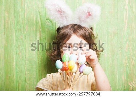 Girl with bunny ears and little eggs. Easter celebration - stock photo