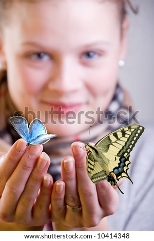 Girl with butterflies on her hand