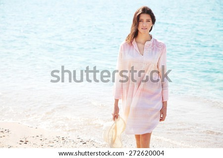 Girl with caftan dress - stock photo