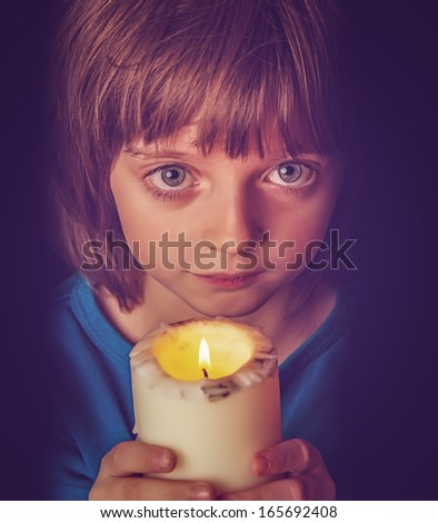 girl with candle  - stock photo