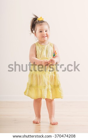 girl with candy indoor - stock photo