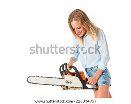 Girl with chainsaw over white background