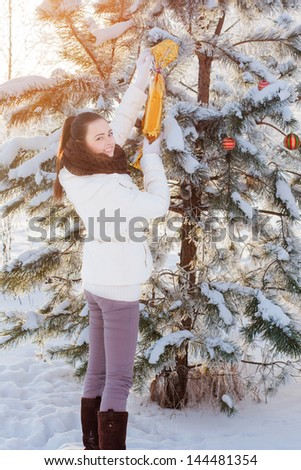 girl with christmas toy outdoor - stock photo