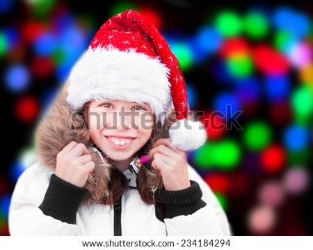 Girl with Christmas tree lights behind - stock photo
