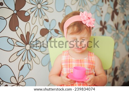 girl with closed eyes sitting on chair - stock photo