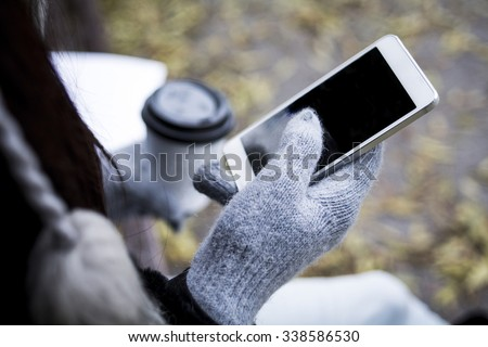 Girl with coffee and mobile phone  - stock photo