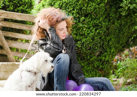 Girl with colored hair, smile and miniature whit schnauzer