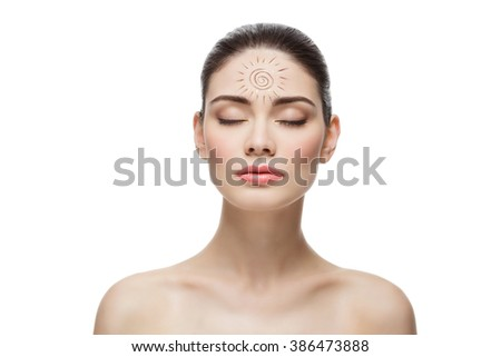 Girl with cream sun shape drawing on chest - stock photo