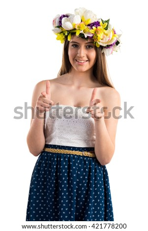 Girl with crown of flowers pointing to the front