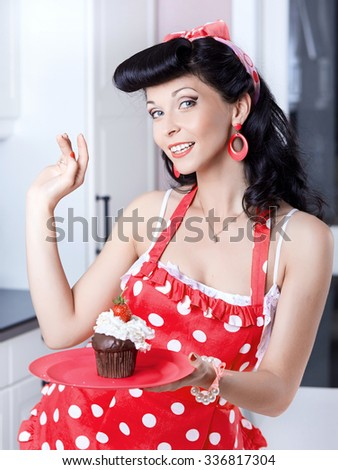 Girl with cupcake on platter - stock photo